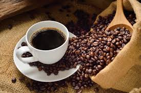 Cup of coffee with coffee beans - Coffee facts