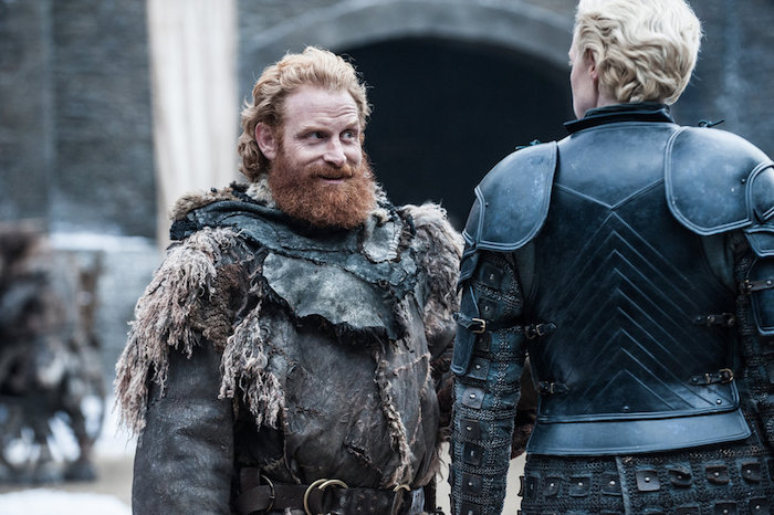A still from Season 7 of Game Thrones with Tormund looking at Brienne of Tarth