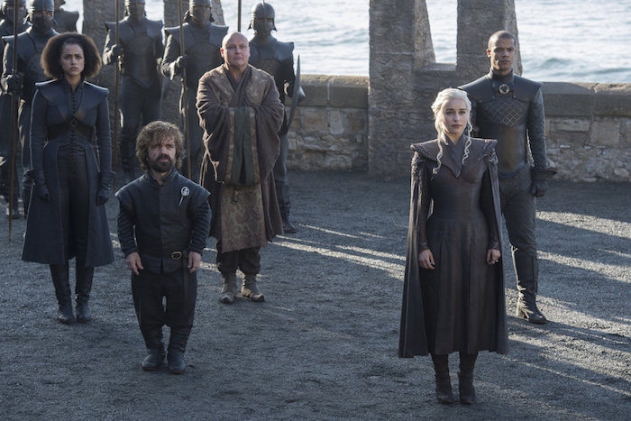 Daenerys Targaryen with her group of trusted advisors prepares to meet someone important in a scene from Game of Thrones Season 7
