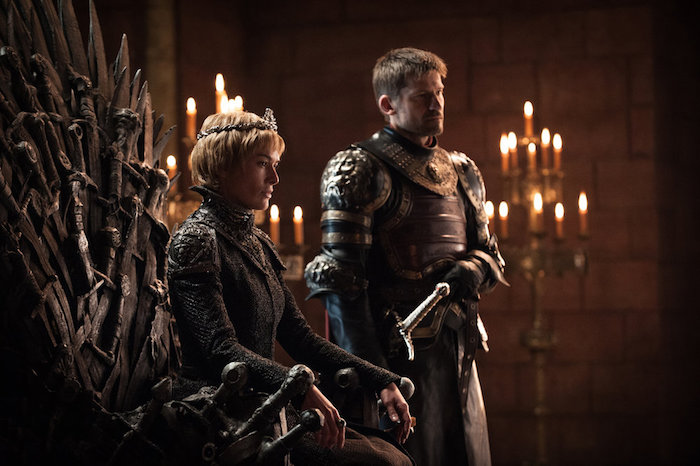 A scene from King's Landing showing Queen Cersei on the Iron Throne flanked by Jaime Lannister