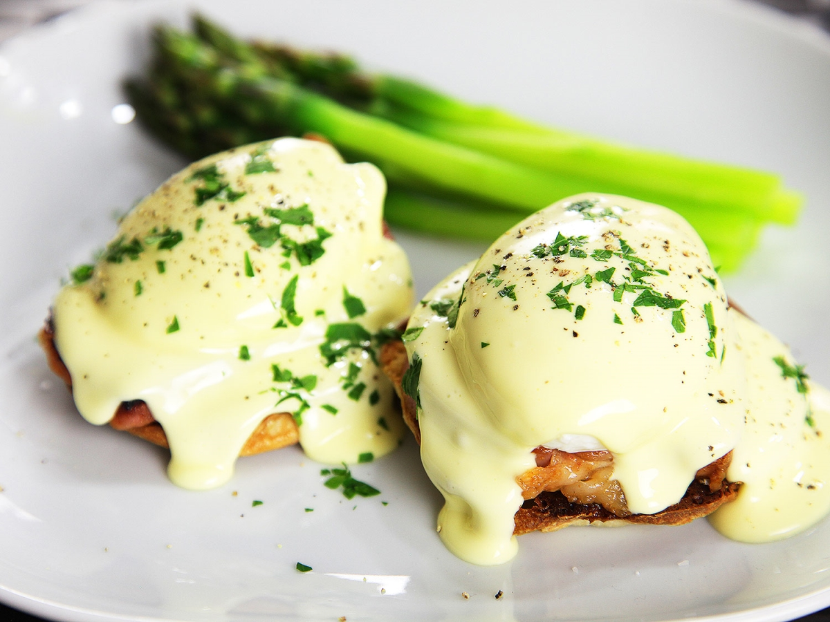 Hollandaise sauce served on eggs Benedict. Dutch sauce served on eggs Benedict